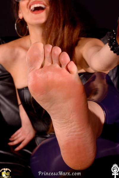 62 High Definition pictures: Watch Professional Dominatrix and Foot Goddess Princess Marx show off Her sexy feet & hot pink toes while wearing tight purple latex-y leggins! She wiggles, scrunches, and spreads Her toes, rubs Her feet together, presses Her feet on the floor, and shows off Her soft soles. Hi Def - you can even see the healing cut on one of Her feet! She holds a pair of killer heel-less, 2-inch wooden platform heels in black suede leather & spikes (by the genius Jeffrey Campbell) in Her hands in several pictures. HD Pics Los Angeles Boston Dominatrix Female Supremacy